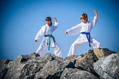 Children training karate on the stone coast Royalty Free Stock Photos