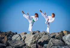 Children training karate on the stone coast Stock Image