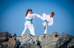 Children training karate on the stone coast Stock Photography