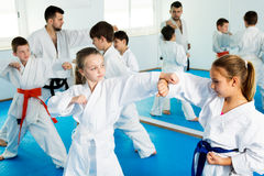 Children training in pairs Royalty Free Stock Image