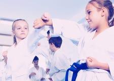 Children training in pairs Stock Images