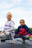 Children training on stadium stretching Royalty Free Stock Image