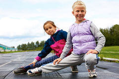 Children training on stadium stretching Royalty Free Stock Photo