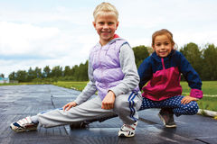 Children training on stadium stretching Royalty Free Stock Images