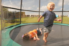 Children on trampoline Royalty Free Stock Photo