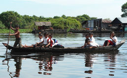 Children Traveling by Boat Stock Images