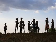 Children of the tribe of Hamar in the evening stock photos