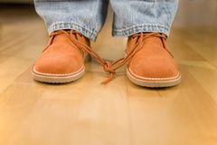 Children trick. Student with knotted laces - symbolic of student pranks stock photos