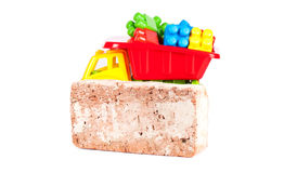 Children truck with red brick Royalty Free Stock Photography