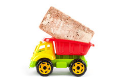 Children truck with red brick Stock Photography