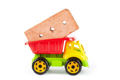 Children truck with red brick Royalty Free Stock Images