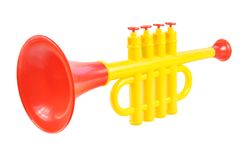 Children trumpet made of colored plastic. Against white background Stock Photos