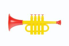 Children trumpet made of colored plastic. Against white background Royalty Free Stock Image