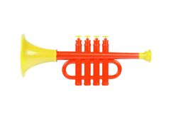 Children trumpet made of colored plastic. Against white background Royalty Free Stock Photos