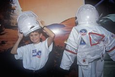 Children try on $1 million spacesuit at Space Camp, George C. Marshall Space Flight Center, Huntsville, AL Stock Image