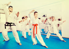 Children trying martial moves in karate class. Children trying new martial moves in the practice during karate class Royalty Free Stock Photos