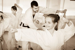 Children trying martial moves in karate class. Children trying new martial moves in practice during a karate class in the gym Stock Image