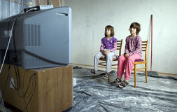 Children for the TV-set. In the room under reconstruction Royalty Free Stock Photos