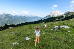 Children - twin girls are hiking in the mountains. Royalty Free Stock Photo