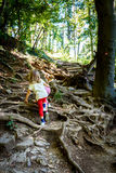 Children - twin girls are hiking in the mountains. Stock Photo