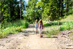 Children - twin girls are hiking in the mountains. Stock Images