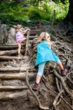 Children - twin girls are hiking in the mountains. Stock Image