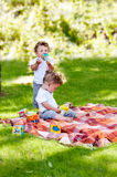 Children Twins Drink Water From A Bottle Stock Images