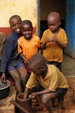 Children in Uganda. Coffee farmers in Uganda husk coffee by hand children Stock Images