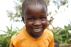 Children in Uganda. A young boy from Uganda smiles. This picture is from Tegeres Village on Mount Elgon in eastern Uganda Stock Image