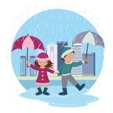 Children with umbrellas in the rain Stock Photo