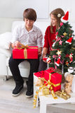 Children under Christmas tree. Unwrap gifts Royalty Free Stock Photos