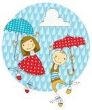 Children under umbrellas. Two children hiding from the rain under umbrellas Royalty Free Stock Images