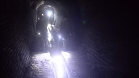 Children in the underground tunnel stock video