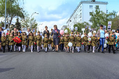 Children in uniform hold portraits of relatives in the Immortal regiment on 9 May, 2016 in Ulyanovsk, Russia royalty free stock photography