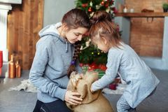 Children unpack surprise for Christmas. The concept of holidays stock photos