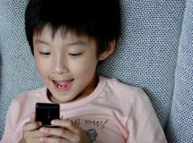 Children use mibile photo Royalty Free Stock Image