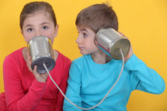 Children using cans as phone Royalty Free Stock Images