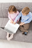 Children using laptop computer royalty free stock photography