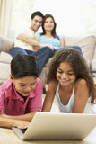 Children Using Laptop At Home Royalty Free Stock Photos