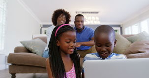 Children using laptop in living room. At home stock footage