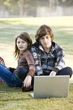 Children using laptop in park Stock Image