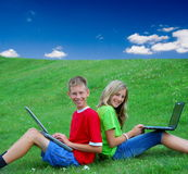 Children using laptops outside Royalty Free Stock Photo