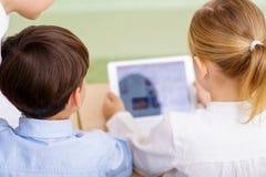 Children using portable tablet Stock Photo