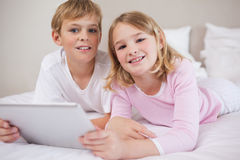 Children using a tablet computer Stock Photo