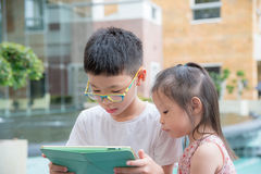 Children using tablet computer Royalty Free Stock Images
