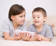 Children using tablet computer. Happy children using tablet computer Stock Image