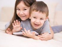 Children using tablet computer. Happy children using tablet computer Royalty Free Stock Image