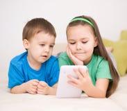 Children using tablet computer. Happy children using tablet computer Royalty Free Stock Photos