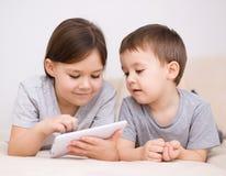 Children using tablet computer. Happy children using tablet computer Stock Photos