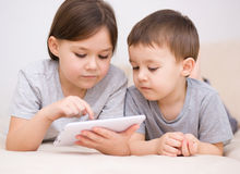 Children using tablet computer Stock Images